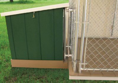 dig box attached to chain link dog kennel